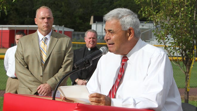 North Rockland High School athletic director Joe Casarella speaks during a ceremony to dedicate the 9/11 Memorial Fields at the school Sept. 10, 2011. The memorial consists of a tree-lined walkway with benches and a boulder bearing the names of those lost on 9/11with ties to the school district.