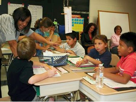 Attendees at a recent math workshop at Hamilton Heights Elementary sat in on a third-grade math lesson in which the Investigations curriculum was being taught.