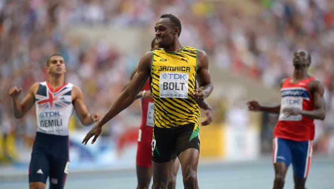 Usain Bolt (JAM), center defeats Adam Gemili (GBR) and Churandy Martina (NED) to win the 200 in 19.66 at the  IAAF World Championships at Luzhniki Stadium in Moscow on Saturday.