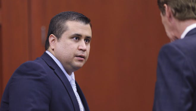 George Zimmerman, left, confers with his attorney, Mark O'Mara, on July 12 after the jury began deliberations during his murder trial.