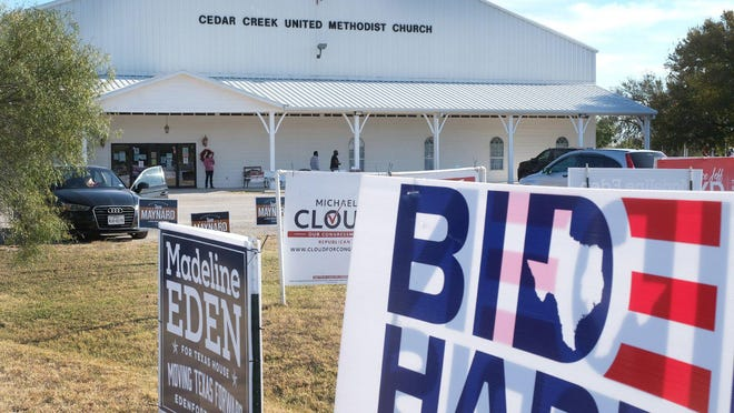 Cedar Creek United Methodist Church's frontage is filled with campaign signs on Election Day. The church served as a polling location for Precinct 3015.