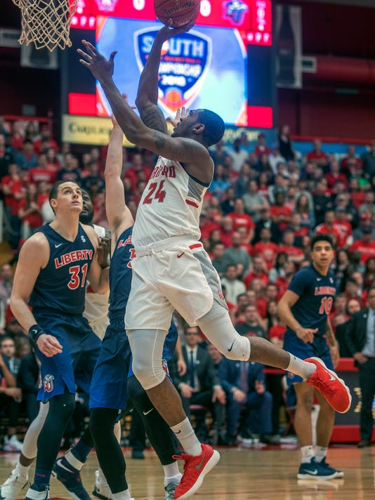FILE - In this March 4, 2018, file photo, Radford forward Ed Polite Jr. (24) shoots over Liberty forward Scottie James (31) during the first half of a Big South Conference championship NCAA college basketball game in Radford Va. After finishing sixth in the Big South last season, Radford was picked in preseason polls to finish near the bottom of the conference again. (AP Photo/Don Petersen, File)