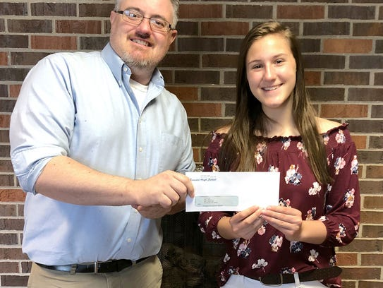 Nicole Wagner (right) presents a check from the Mr.