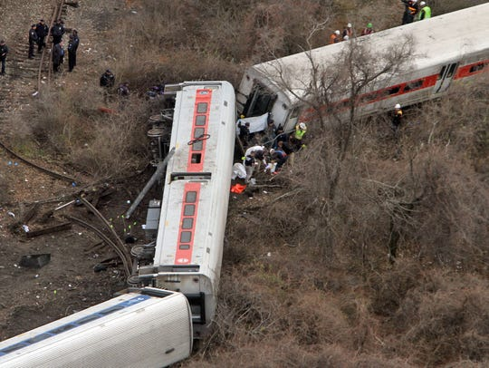 Emergency personnel work at the scene of a Metro-North train that derailed just north of the Spuyten Duyvil station in the Bronx on Dec. 1, 2013.