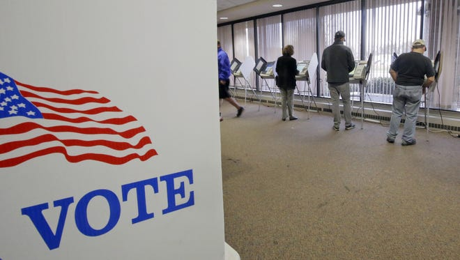 People vote early at the Salt Lake County Government Center on Tuesday in Salt Lake City. People vote during early voting for the 2016 General Election at the Salt Lake County Government Center on Tuesday, Nov. 1, 2016.