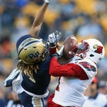 Nov 21, 2015; Pittsburgh, PA, USA; Louisville Cardinals wide receiver Jamari Staples (R) catches a pass against Pittsburgh Panthers defensive back Avonte Maddox (14) during the first quarter at Heinz Field. Mandatory Credit: Charles LeClaire-USA TODAY Sports