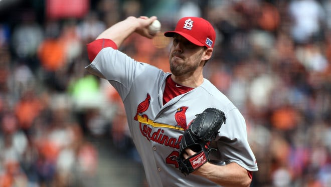 John Lackey was 14-10 with a 3.83 ERA last year with the Red Sox and Cardinals.