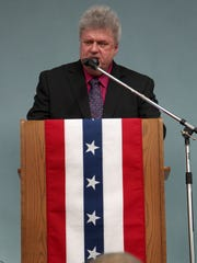 Robert Nueske speaks at the rededication ceremony for the village's newly remodeled band shell on September 11, 2013.