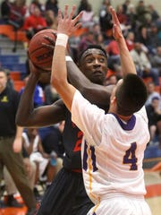 Stewarts Creek's Terrell Brown (20) goes up for a shot