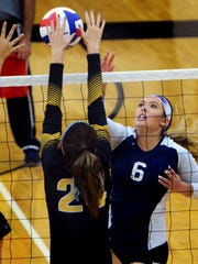 Dallastown's Delany Kolb has a return blocked by Red