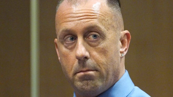 Suspended Edison Police Officer Christian Pedana, 45, appears in Middlesex County Court  in New Brunswick on Friday, Sept. 29. Pedana, accused of plotting with a former cop to firebomba captain's home in 2013, was sentenced to pay fines and fees.