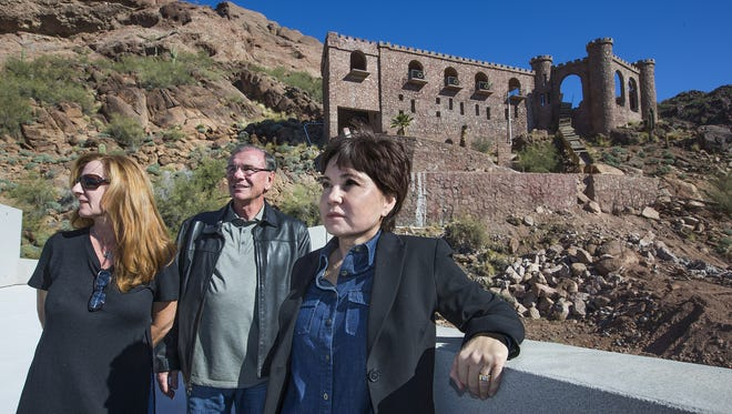 Construction debris litters part of the property formerly known as the Copenhaver Castle on Camelback Mountain. Neighbors as upset at the eyesore that can easily be seen from nearby homes.  From left, neighbors Krista and Ronald Moyes (married) and Linda Bair are just some of the nearby residents that are unhappy.