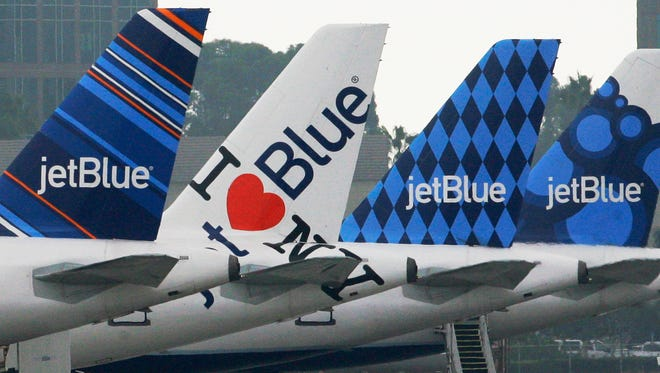 JetBlue planes are seen at the JetBlue terminal at Long Beach Airport in this file photo from Oct. 25, 2011.