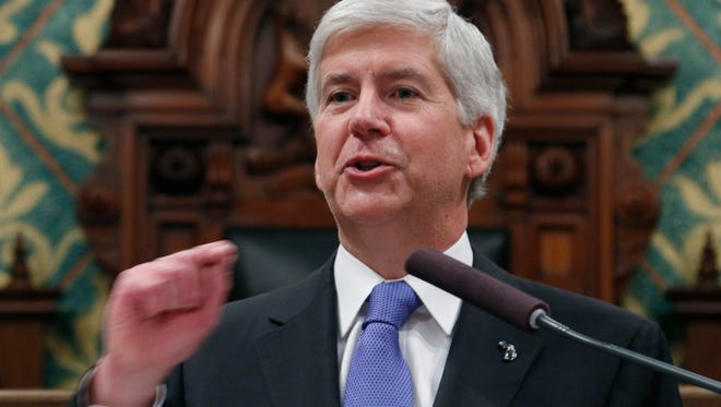In this Jan. 20, 2015 file photo, Michigan Gov. Rick Snyder speaks at the state Capitol in Lansing, Mich.