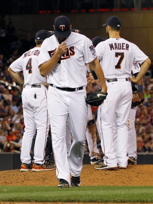 Minnesota Twins starting pitcher Mike Pelfrey leaves the mound after being replaced by Blaine Boyer during the eighth inning of a baseball game against the Detroit Tigers in Minneapolis, Thursday, July 9, 2015. The Tigers won 4-2. (AP Photo/Ann Heisenfelt)