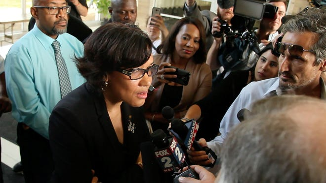 Flint Mayor Karen Weaver appears after Monday's news conference in Flint.