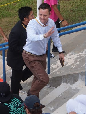 Guam men's national soccer team head coach Gary White waves to fans prior to a home match against Oman at the Guam Football Association National Training Center on Sept. 8, 2015.