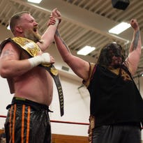 """Toby Cline and """"The Monster"""" Abyss pose for the crowd after their main event match at """"ASWA Eruption"""" on June 4."""