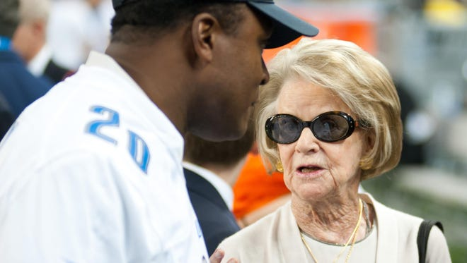Martha Ford speaks to Lions great Barry Sanders before a game in October. She owns the Lions, but her four children all have the title of vice chair — and Sheila Ford Hamp has taken a big role.