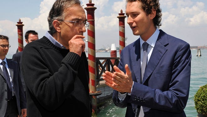 Fiat and Chrysler CEO Sergio Marchionne, left, talks with Chairman John Elkann on the occasion of the 22nd meeting of The Council for the United States and Italy, in Venice's San Clemente island, Italy, Saturday, June 4, 2011.