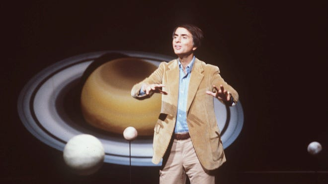 """Astronomer Carl Sagan hosted the 13-part """"Cosmos"""" series on PBS in 1980. The reborn """"Cosmos"""" debuts Sunday."""