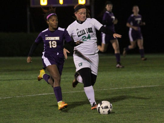 Clear Fork's Whiteny Snavely keeps the ball away from