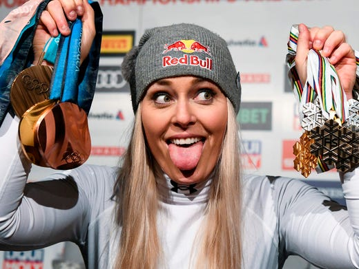 Lindsey Vonn poses with her medals following the press conference for her last ever race.