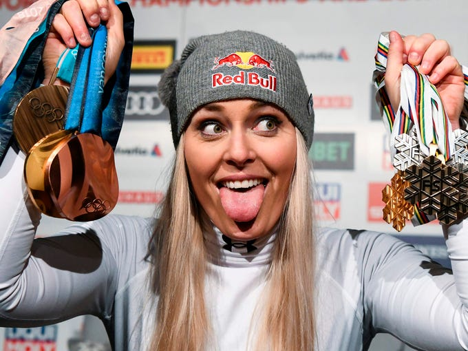 lindsey-vonn-poses-with-her-medals-following-the-press