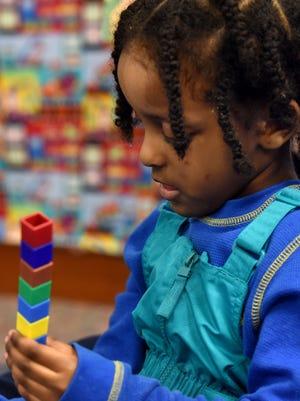 Garfield Elementary pre school student Liya Haile uses building blocks during class on Monday, Feb. 6, 2017.