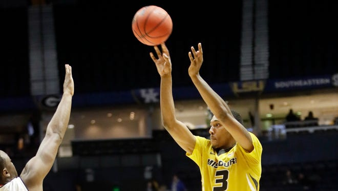 Missouri guard Frankie Hughes (3) hits a 3-point shot against Auburn at the end of the second half of an NCAA college basketball game in the Southeastern Conference tournament Wednesday, March 8, 2017, in Nashville, Tenn. The basket sent the game into overtime. Missouri won 86-83. (AP Photo/Wade Payne)