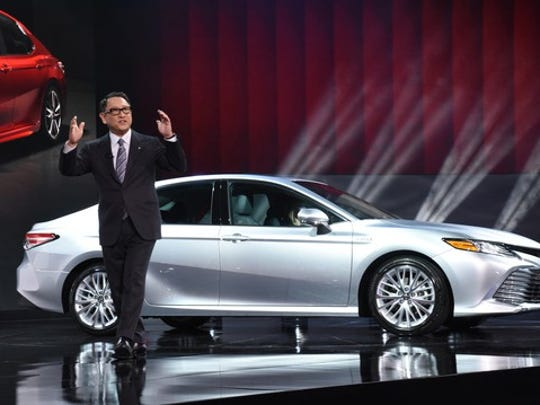 Toyota CEO Akio Toyoda introduces the redesigned Camry at the Detroit auto show in January 2017.