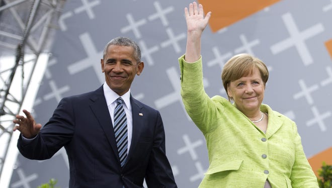 German Chancellor Angela Merkel and former president  Barack Obama arrive for a discussion on democracy at Church Congress on May 25, 2017 in Berlin, Germany.