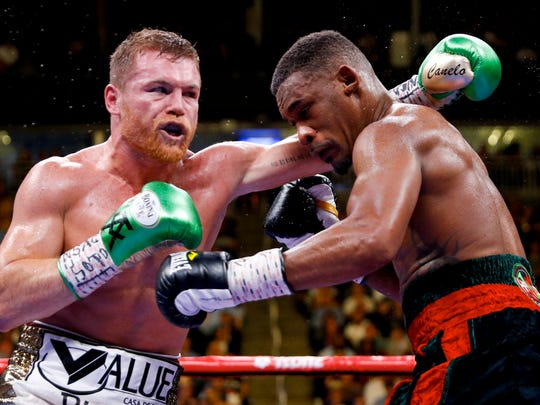 Canelo Alvarez, left, of Mexico, fights Daniel Jacobs in a middleweight title boxing match Saturday, May 4, 2019, in Las Vegas. (AP Photo/John Locher)