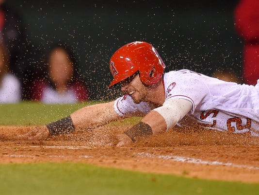 Los Angeles Angels' Johnny Giavotella scores on a sacrifice fly by Carlos Perez during the fifth inning of a baseball game against the Los Angeles Dodgers, Wednesday, May 18, 2016, in Anaheim, Calif. (AP Photo/Mark J. Terrill)