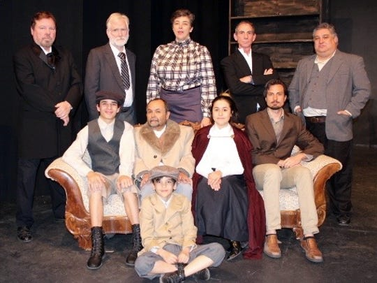 """Enemy of the People"" cast, top, from left, include Marc Steffen, David Edwards, Sarah Sayles, Mark Boudreau and Teddy Aspen-Sanchez; and bottom, from left, Christopher Hamilton, Ed Montes, Jessie Montoya Ortega and Spencer Taylor. Santiago Garzon is sitting on the floor."