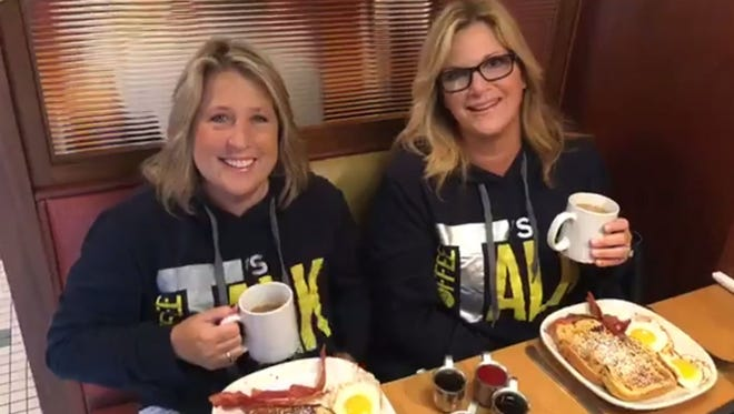 """Trisha Yearwood, right, poses with her friend Mandy McCormack at Phillips Avenue Diner in Sioux Falls on Saturday. The two were shooting Yearwood's Facebook Live show """"T's Coffee Talk."""""""