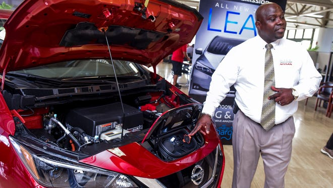Sales Consultant Timothy Hall points out the quick charge port as he introduces some of the features that could be found on the 2018 Nissan LEAF at the Nissan Guam showroom in upper Tumon on Tuesday, April 24, 2018. The 100% electric powered vehicle is promoted with zero tailpipe emissions and embodies Nissan Intelligent Mobility, which includes the ability to: maintain the distance to the vehicle in front, using a speed and distance preset by the driver; help keep the vehicle centered in its lane; automatically apply the brakes to help bring the vehicle to a full stop if necessary and accelerate, decelerate or stop the car by using the revolutionary e-Pedal accelerator alone, according to a Nissan release.