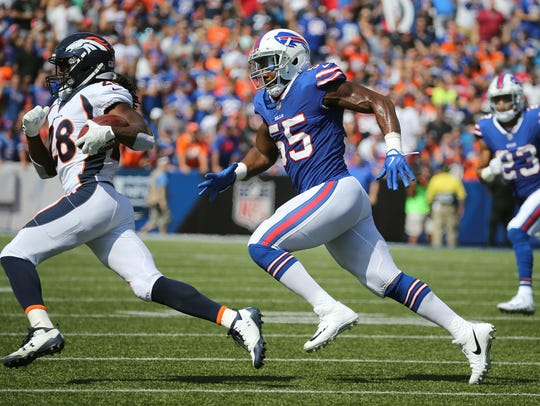 Bills linebacker Jerry Hughes (55) chases Broncos running