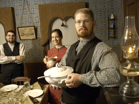 Living History Farms staffers Travis Risvold, Allison