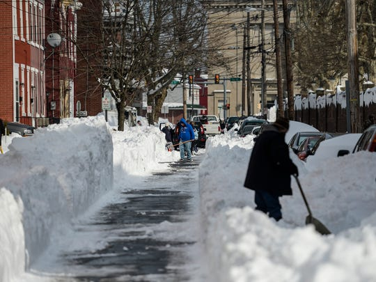 People dig out on Church Street in Lebanon as people continued to dig out from snowstorm Jonas on Monday, Jan. 25, 2016. The snowstorm slammed Pennsylvania Friday, Jan. 22 and Saturday, Jan. 23 dropping close to 29 in. of snow on Lebanon County.