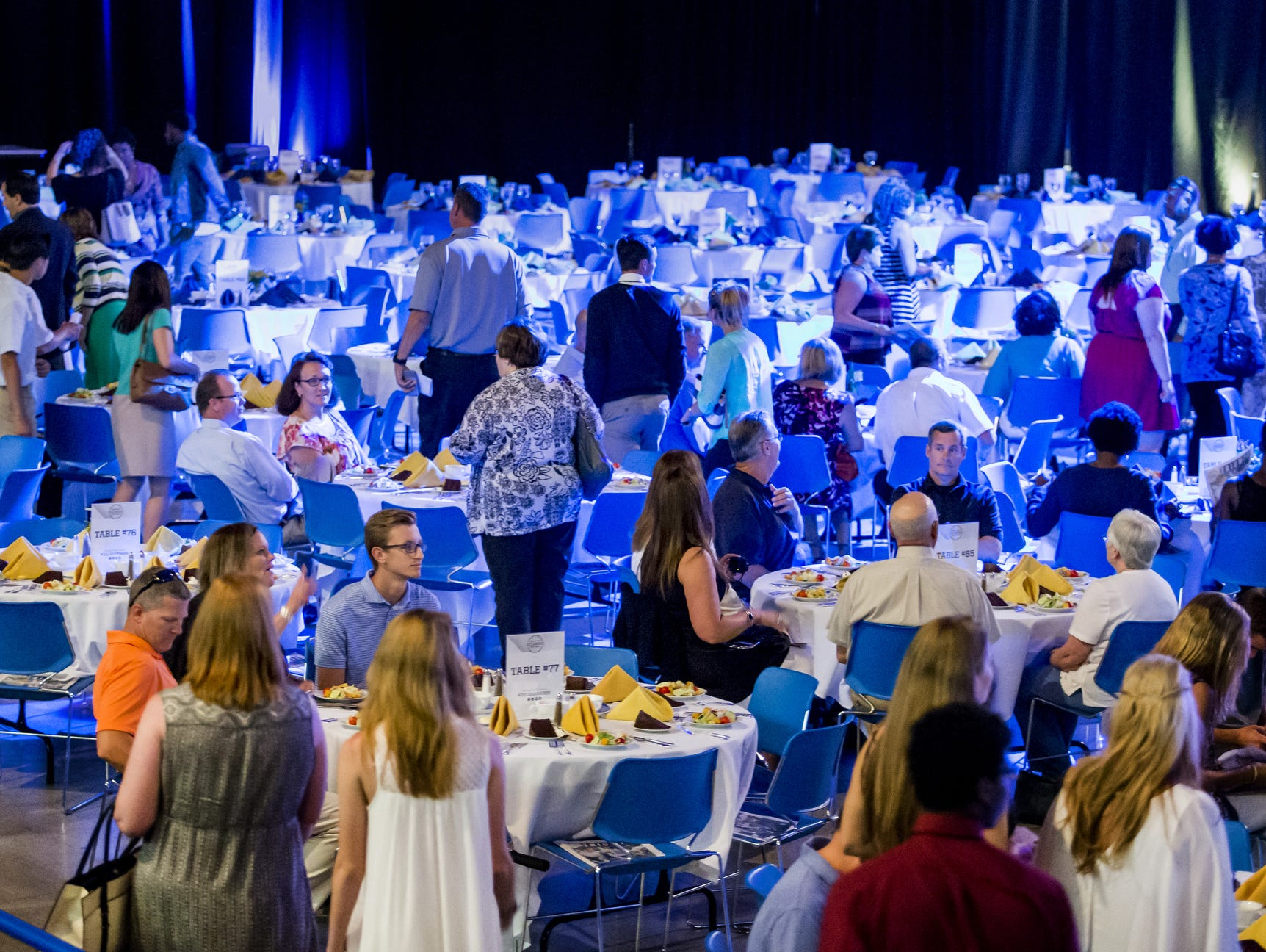 Guests at the Delaware Sports Awards banquet make their to their tables at the Bob Carpenter Center at the University of Delaware in Newark on Wednesday evening.