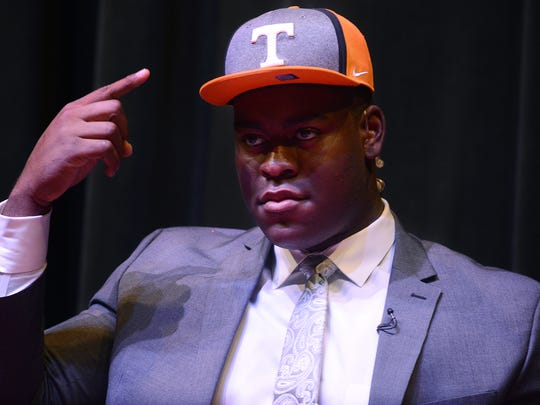 University School of Jackson senior lineman Trey Smith raises his fist in celebration with the audience after choosing The University of Tennessee as his commitment choice, Tuesday afternoon.