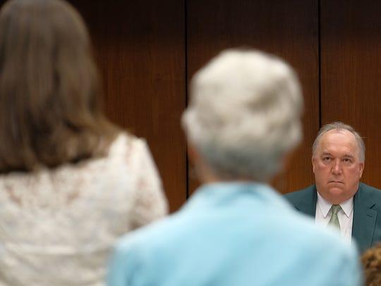MSU Interim President John Engler listens to criticism