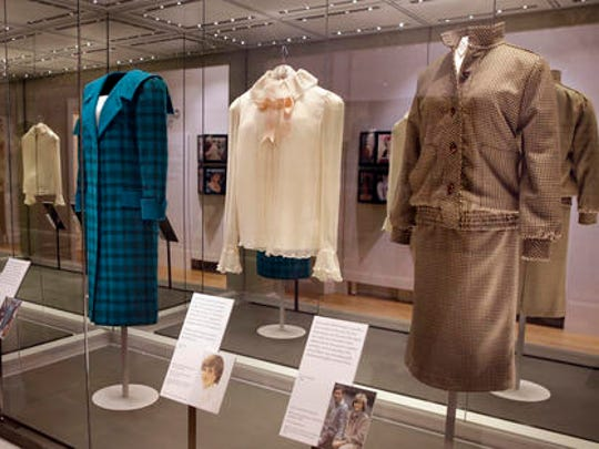 "A selection of coats and outfits worn by Diana, Princess of Wales, including at right, a brown tweed wool day suit by Bill Pashley, which she wore on her honeymoon in Scotland 1981, during a media preview of an exhibition of 25 dresses and outfits worn by Diana, Princess of Wales entitled ""Diana: Her Fashion Story"" at Kensington Palace in London, Wednesday, Feb. 22, 2017."