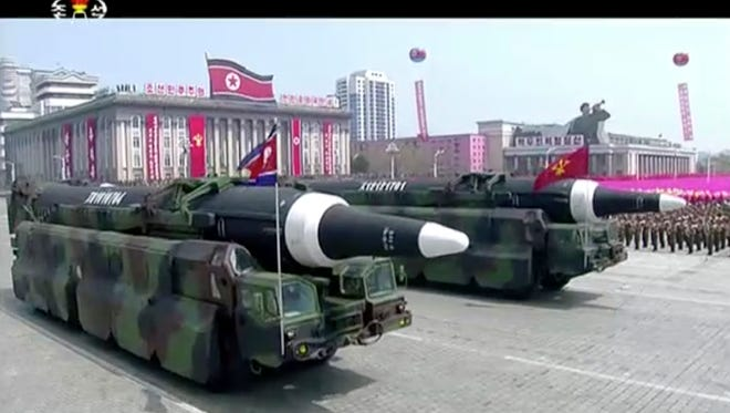 In this image made from video provided by North Korean broadcaster KRT, missiles are paraded at Kim Il Sung Square in Pyongyang on April 15, 2017.