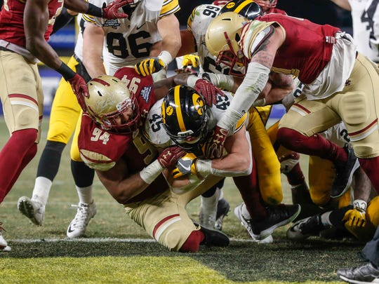 Iowa fullback Drake Kulick pounds his way into the end zone to put Iowa up for good as the Hawkeyes won, 27-20, over Boston College during the 2017 Pinstripe Bowl at Yankee Stadium in Bronx, New York on Wednesday, Dec. 27, 2017.