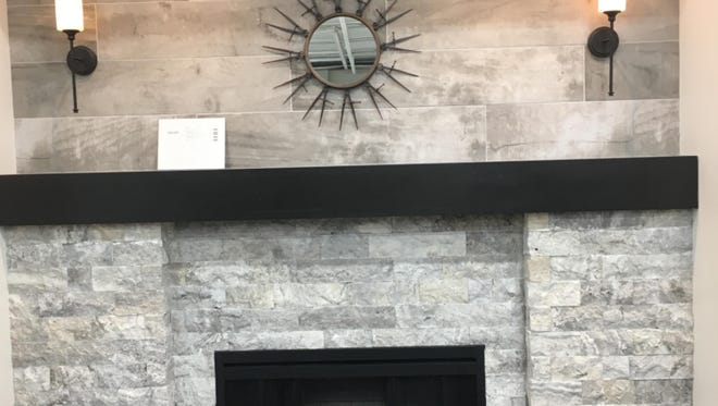 Carefully chosen tiles can make a fireplace a spectacular focal point for a room, as this new vignette at The Tile Shop, 1701 S. 108th St., shows.