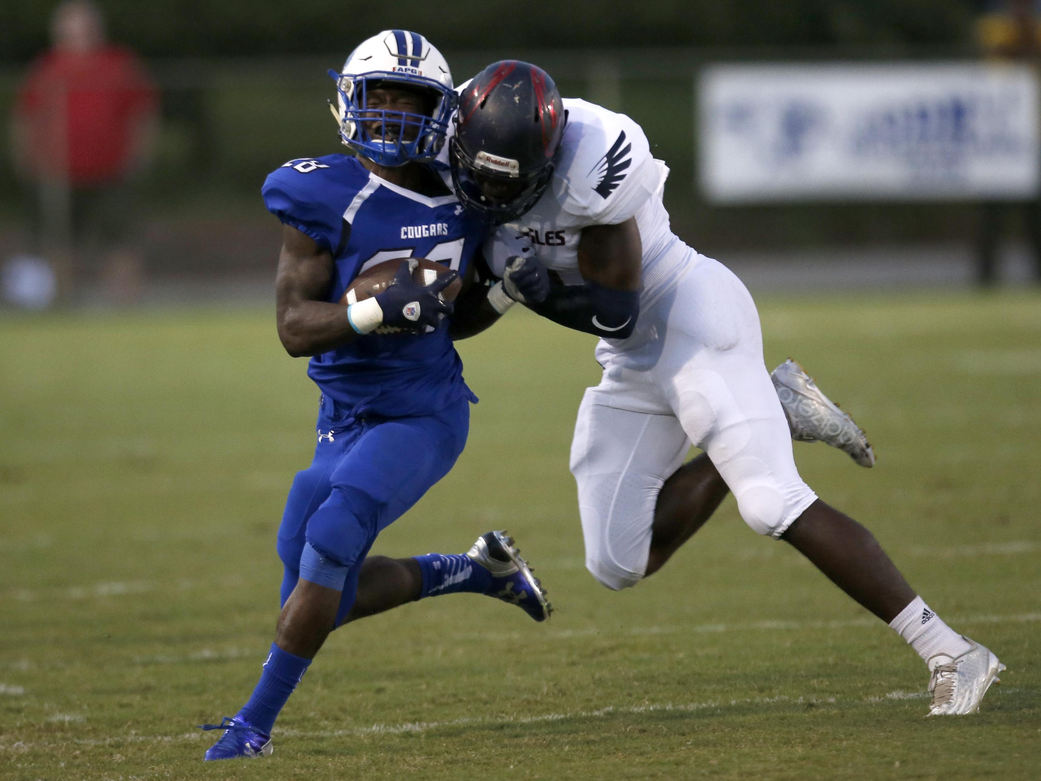 Wakulla's Keith Gavin drives Godby's Tyquan Watson out of bounds in a hard collision during the two team's game last week. Wakulla won 15-6, solidifying its spot atop the power rankings.
