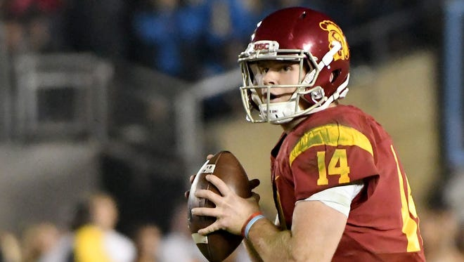 USC Trojans quarterback Sam Darnold (14) sets up to pass the football in the second half against the UCLA Bruins at the Rose Bowl.