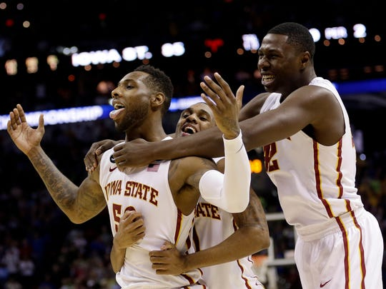 Iowa State's DeAndre Kane (50) is grabbed by teammates Monte Morris, center, and Daniel Edozie, right, after making the game-winning basket against North Carolina during the second half of a third-round game in the NCAA college basketball tournament Sunday, March 23, 2014, in San Antonio. Kane has played for Overseas Elite in The Basketball Tournament the past two years and won two championships.